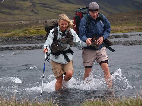 P7124924 Pernille and Ulrik crossing ice cold river at Landmannalaugar trek, Iceland