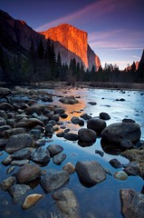 Sunset on El Cap (Nick Carver Photography) Tags: california park travel winter sunset usa mountain mountains reflection tourism nature water rock reflections river relax landscape outdoors landscapes rocks calm boulder boulders alpine valley rivers serenity western serene yosemitenationalpark wilderness elcapitan sierranevada relaxed valleyview yosemitevalley centralcalifornia mercedriver wildlifereserve natureparks ncpfineartprint nationalparksystem