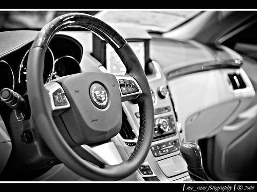a black and white of a cadillac interior
