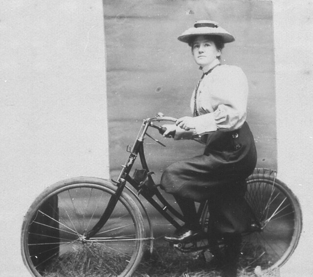 Annie Dawson Wallace with her bicycle. NB: Annie is wearing trousers - Sydney, NSW, 1899