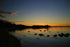 a summer evening, three months late... (lachlansear) Tags: longexposure blue sunset orange reflection water clouds lights bay pier rocks australia victoria mornington mybirthday lachlansbirthday