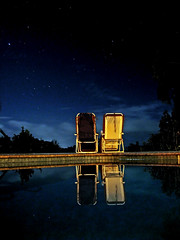 empty chairs, full sky (sandcastlematt) Tags: longexposure reflection pool night stars march chairs puertorico contest swimmingpool bb bedandbreakfast vieques thegreatescape 15seconds bostoncom