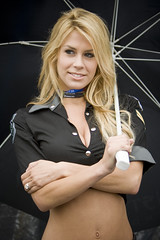 Umbrella Girls (Brian Neufeld) Tags: california woman hot cute sports smile monterey model teeth blond babes motogp usgp bellybutton navel midriff gridgirls motorcycleracing umbrellagirls outie promogirls kawasakiracing mazdaracewaylagunaseca