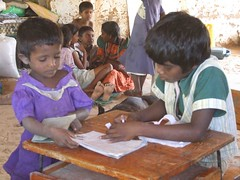 children studying/drawing (trokilinochchi) Tags: boy food water girl army refugee sri lanka shelling medicine persons shelter temporary situation organization starvation studying tamil bombing vanni rehabilitation tro displaced mannar eelam idp kilinochchi mullaitivu internally humantarian tarmils