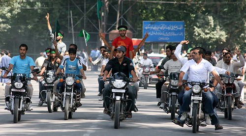 Kashmiri Muslims on bikes shout pro-freedom