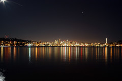 Downtown from Gas Works Park (Shutterbug Fotos) Tags: seattle longexposure water colors night buildings reflections lights downtown cityscape spaceneedle sensational lakeunion gasworkspark emeraldcity urbanlandscape themoon buildingreflection jetcity moonburst colourartaward