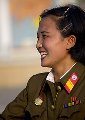 Smiling soldier North Korea  (Eric Lafforgue) Tags: pictures travel woman girl female canon asian soldier army photo women war asia military femme picture korea kimjongil asie coree fille journalist militaire soldat journalists northkorea armee pyongyang  dprk  coreadelnorte juche kimilsung 3085 nordkorea lafforgue   ericlafforgue sariwon   coredunord coreadelnord  northcorea coreedunord rdpc  insidenorthkorea  rpdc   demokratischevolksrepublik coriadonorte northkoreanarmy  armeenordcoreenne kimjongun coreiadonorte