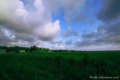 IMG_3959 (Adi Sabatdiman or Adi Sabardiman) Tags: sky grass clouds canon sigma land adi 1020 456 400d sabatdiman