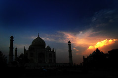 Taj Mahal, Agra, India (Jitendra Singh : Indian Travel Photographer) Tags: travel sunset sky blackandwhite orange sun india reflection history monument rain yellow horizontal architecture clouds square outdoors photography evening vanishingpoint memorial scenery asia paradise arch colours minaret tomb wide taj tajmahal agra bluesky palace unescoworldheritagesite cpc mausoleum marble oniondome muslimculture formalgarden mughal jiten travelphotography mansoon jitendra traveldestinations buildingexterior 5photosaday internationallandmark indiansubcontinent jitender eveninglights mughalempire mywinners travelphotographer jitendrasingh builtstructure theunforgettablepictures indiaphoto jitens traditionallyindian indiantravel incidentalpeople iloveyouindia wwwjitenscom jitensmailgmailcom wwwindiantravelphotographercom