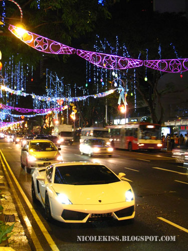 white lambogini on orchard road