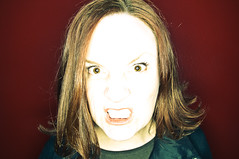FIERCE!!! (poopoorama) Tags: red portrait woman wall nikon sigma margaret ringflash orbis d300 strobist 1850mmf28exmacrohsm orbis09q1
