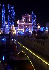 Ljubljana on new year's eve (catalessio) Tags: bridge pink blue trees light building church night colours ljubljana slovenija lubiana kunstplatzlinternational kunstplatzlinternational5