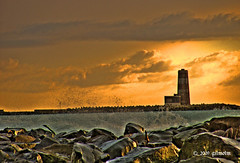 Lighthouse (gilmolm) Tags: sunset sea sky italy lighthouse rome roma beach clouds photoshop canon faro rocks italia tramonto nuvole mare cielo spiaggia hdr fiumicino lazio scogli cubism tonemapping flickraward colourartaward platinumheartaward flickrestrellas quarzoespecial canonpowershotsx110is farodifiumara freedancephotographers