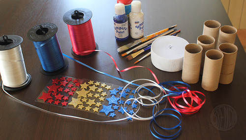 supplies for patriotic streamers (ribbon, paint, star stickers, empty toilet paper rolls)