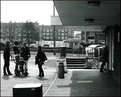Little London Post Office II (James W Bell (Good Honest Iago) - Leeds) Tags: people public photography estate urbandecay postoffice leeds streetphotography flats highrise shops pedestrians council housing streetphoto innercity unposed brutalism towerblock deprivation councilestate towerblocks councilflats socialhousing littlelondon kodakz700 urbanregeneration april2008 peopleunposedinpublic midcenturyhousing shopparade terminallyilldyingleeds deprivedarea