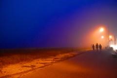 Beachcombers (D.M. Cook) Tags: road blue light boy shadow orange mist man men beach boys silhouette yellow misty fog night walking three newjersey twilight sand streetlight profile foggy nj shore midnight capemay mu