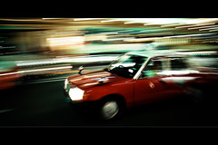 Horizontals: Speed of light (manganite) Tags: street city light red urban motion blur streets color cars topf25 japan night digital geotagged lights interestingness nikon kyoto colorful asia nightshot traffic tl framed taxi perspective streetscene explore 日本 nippon gion d200 nikkor dslr panning kansai nihon streetshot neonlight avl interestingness94 i500 18200mmf3556 utatafeature manganite nikonstunninggallery geo:lat=35003737 date:year=2006 geo:lon=135761946 date:month=august date:day=25 format:orientation=landscape format:ratio=21
