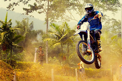 Man and machine (DSC6363) (Fadzly @ Shutterhack) Tags: travel vacation people holiday hot sports nature bike sport race d50 asian championship jump movement nikon asia zoom action beijing fast competition racing motorbike dirt telephoto human will malaysia tropical motorcycle tropic motor dirtbike kuala win olympic extremesports olympics lose 2008 motocross challenge asean winning stunt terengganu equator humid xgames mys mensen sukan compete   mennesker kenyir  sigmaapo70200mmf28exdghsm olimpik nikonstunninggallery motosikal shutterhack lumbalasak