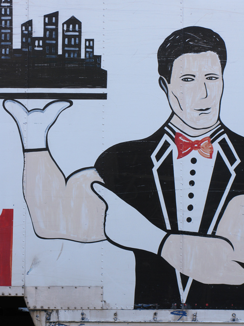 man with white gloves in a mural on a truck