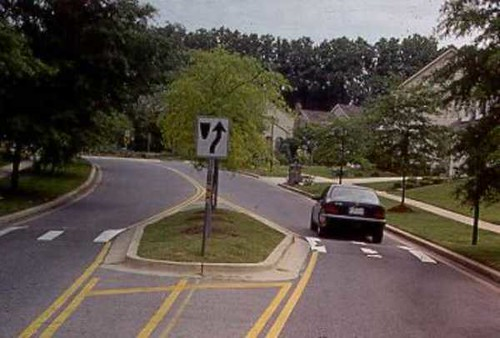 traffic calming with combined speed humps and island (by; Federal Highway Administration)