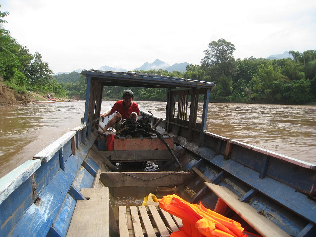 Leaving the bikes behind, we take a boat upriver