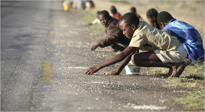 children in Zimbabwe scavenging for rice
