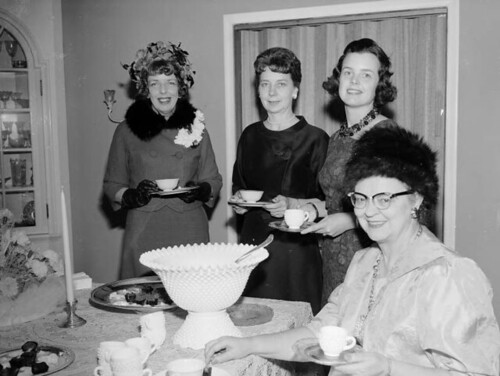 Lunching ladies with hats by Marriott Library, University of Utah.