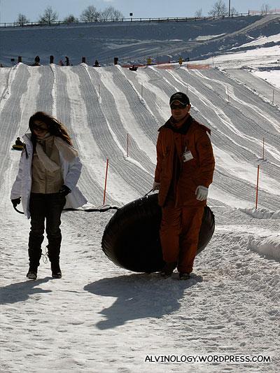 Staff helping lazy Meiyen clear her sled