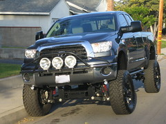 Front end view of custom lifted Tundra.