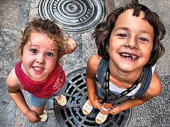 Paula & Mireia (ToniVC) Tags: girls girl smile kids canon tooth children happy funny child floor pavement teeth daughter happiness powershot paula cousin 365 sewer hdr havingfun aprilfool mireia tonemapped twtmeblogged a640 tonivc fanpor