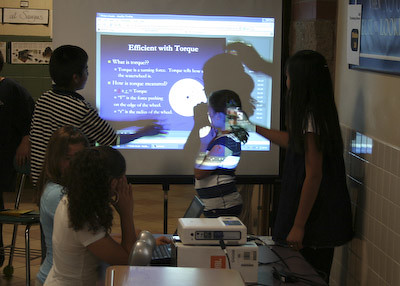 Students show how they learned to create an efficient waterwheel using Adobe Presenter.