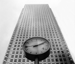 Time for work (timinbrisneyland) Tags: windows england blackandwhite building london clock lines skyscraper reflections europe time shapes canarywharf e14 isleofdogs 210pm
