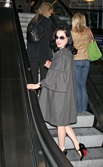 Dita's Red Lips, Nails, and Soles (Mariilyn Monroe) Tags: california usa vintage losangeles airport id retro cape redlipstick lax rednailpolish christianlouboutin anklestrap patentleathermaryjanes graycoat louisvuittonluggage sparrowbroach
