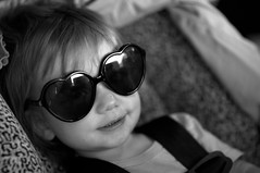 Contingency Plan (Gene Fama) Tags: summer blackandwhite bw sunglasses television interior shades francesca carseat fourthofjuly independenceday straps frannie songlyrics leopardspots lowlit narrowfocus sixteenmonths canonef85mmf12lii tudeshades bwcircularpolarizerfilter heartshades