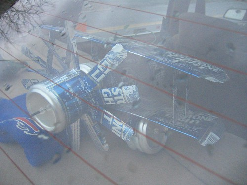 Model plane built from beer cans