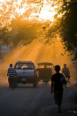 Cambodian Sunset (Discaciate) Tags: street trip sunset cars dusty asia cambodia southeastasia ray cambodians khmerpeople traffic citylife streetphotography transportation tuktuk rays dust siemreap d300 travelphotography discaciate
