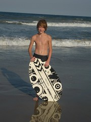 Parker and his board (Thunderpuppy) Tags: beach parker skimboard