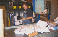 20030926 - USPS - worker cutting open flat mail bundles - loading into flat mail cart - 100-0017 (Rev. Xanatos Satanicos Bombasticos (ClintJCL)) Tags: 2003 virginia mail business worker usps cart 200309 loading 20030926 merrifield unitedstatespostalservice cuttingbundle cuttingbundles flatmailcart flatmail
