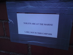 Toilets are at the Marine Lake not in this carpark (Dradny) Tags: morning beach sign wales bench bin views daybreak westkirby hilbreisland