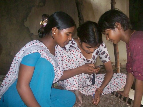 Girls wait for their turn with the phone
