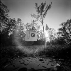 John Deere (alternatePhotography) Tags: trees bw film grass john holga long exposure fuji flags pinhole diafine 100 deere acros pinholga