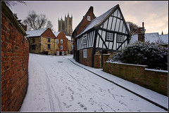 Crooked House Snowy Sunrise (Ally Mac) Tags: old uk england white snow architecture sunrise dawn cathedral lincolnshire lincoln british snowfall cobbles timeless towncentre steephill cht christshospitalterrace michealgate