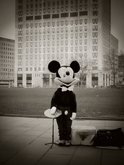 Hard times hit Mickey (Ian Brumpton) Tags: uk england blackandwhite bw white london streetperformers southbank buskers mickeymouse performer busking blackand recession