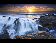 Waterfall at the Beach (danishpm) Tags: ocean beach clouds sunrise canon waterfall rocks australia wideangle nsw aussie aus 1020mm hdr manfrotto sigmalens eos450d hastingspoint 450d bestofaustralia goldstaraward tweedshire hitechgradfilters