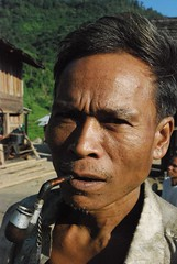 Smoking pipe Laos (Noel Molony) Tags: family children rice health stories waterpumps healthcentre monvillage concernstaff educationonhealth hamkongvillage haumeuangdistrict pakhataivillage pasortvillage salongvillage salorvillage samhouay sopkhamvillage tarkaivillage thathvillage