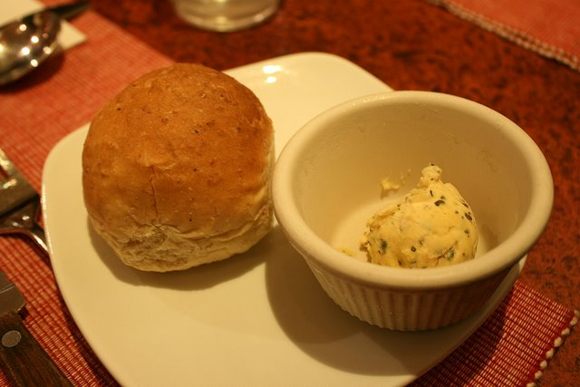 Complimentary warm bread with garlic herb butter
