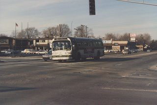 Southbound CTA 1970's era GMC Fishbowl windshield bus at the intersection of West 111th Street and South Pulaski Road in Chicago's Mount Greenwood neighborhood. Chicago Illinois. December 1986.