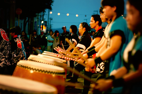 "rolling thunder a <a href=""http://en.wikipedia.org/wiki/Taiko"" target=""_blank"">taiko</a> performance, at the <a href=""http://en.wikipedia.org/wiki/Bon-odori "" target=""_blank"">bon-odori</a> festival in Takikawa.  Try to imagine the power of 20 giant hardwood drums being struck at the exact same time... you can feel it deep down in your gut!  I could easily march into battle to the sound of these things..."