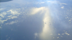 Out a plane window: South China Sea (thewamphyri) Tags: above sea water clouds fromabove planewindow southchinasea viewfromthetop cathaypacific viewfromabove uphigh cathaypacificairways over200views  outaplanewindow