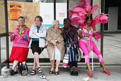 a bench is for life (richard thomson) Tags: carnival london festival topf75 hill busstop notting nottinghillcarnival contradictions visionsinpink decommissionedbusstop decommissioneddancer juxtapositionofopposites temporarilydecommissioned